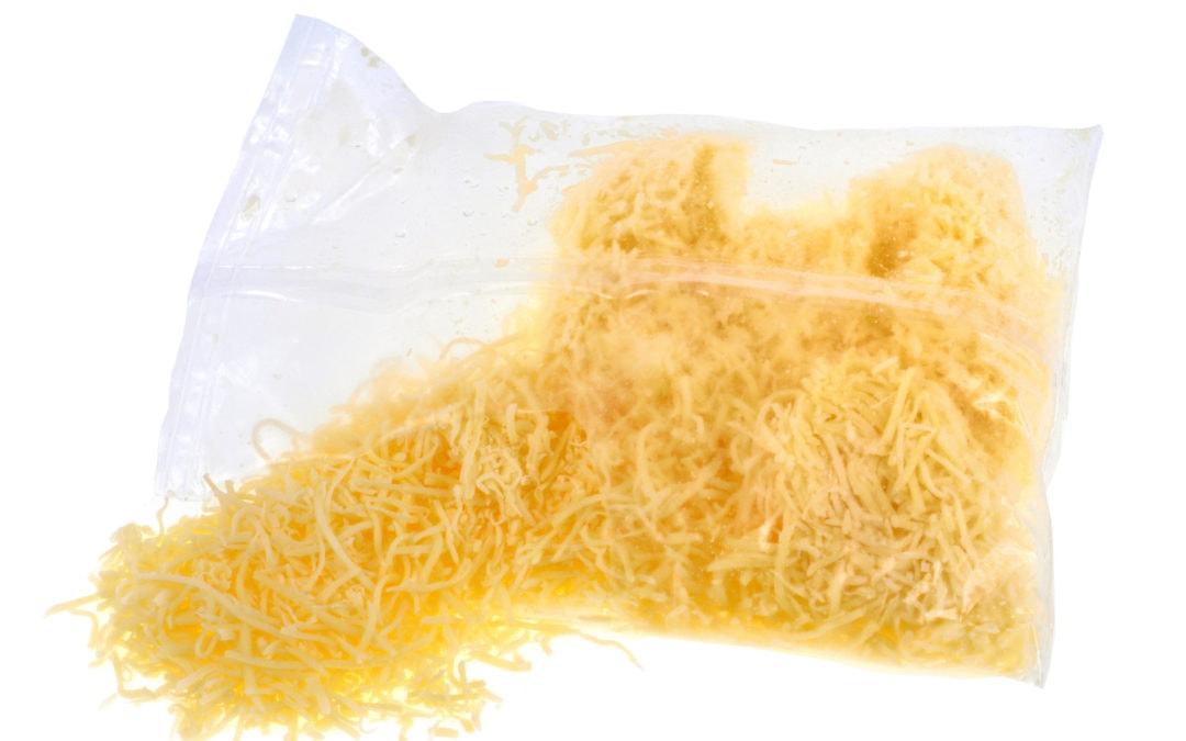 Pas op met verpakte geraspte kaas!